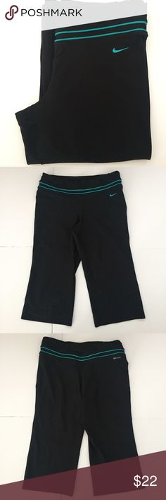 "Nike Black & Teal Blue Yoga Workout Capris - Loose Nike Black Capris with bright teal blue trim! Dri-fit technology. Crop pant is a loos fit around the calf - not tight. 26"" long, inseam 17 1/2"", calf opening 9"", thigh 10"", waist 14 1/2"" laying flat. 88% polyester and 12% spandex. Size small. Good condition- minor wear. NO TRADES. Nike Pants Capris"