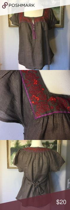 🎀Free People Boho Linen Top🎀 This is a gray, with red and purple stitching and a hook and eye closure with little decorative buttons in the front. Ties in the back, great condition except for in photo #2 you can see where it needs some stitching where the top meets the decorative purple stitching. Free People Tops