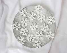 Homemade snow flakes for decorating cakes and even your Christmas tree