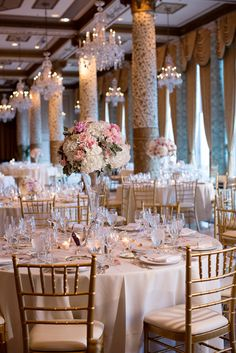 All white wedding reception with gold, possibly a hint of peach or green