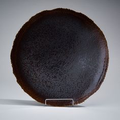 FUJIWO ISHIMOTO FUJIWO ISHIMOTO, A CERAMIC DISH. Signed Ishimoto -04. Arabia Art Department Society, 9th Floor.  Brown glazed. Diameter 52 cm.