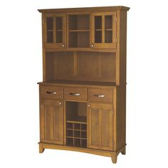 Wood china cabinet in cottage oak with four doors and three utility drawers.  Product: China cabinetConstruction Mat...
