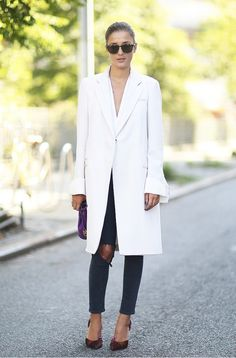 LOVE this long white coat over black skinnies