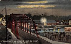 SOUTH HAVEN MICHIGAN DYCKMAN AVENUE LOOKING WEST BY NIGHT  POSTCARD c1914