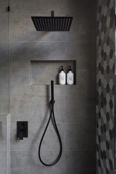 In this modern bathroom, the shower has a matte black rainfall shower head and a hand held shower head, as well as a tiled built-in shelf. - In this modern bathroom, the shower has a matte black rainfall shower head and a. Bad Inspiration, Bathroom Inspiration, Bathroom Ideas, Bath Ideas, Bathroom Organization, Bathroom Renovations, Bathroom Storage, Bathroom Shelves, Bath Shelf