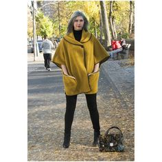 Mean Ms. Mustard Italian Wool Cape Coat  From our Paris shopping excursion comes this stunning mustard yellow 100% Italian Wool Cape Coat with Faux Leather Trim. With a front button closure and two large side pockets, this one size fits all frock with be a lovely addition to your winter wardrobe. Telle Mere, Telle Fille Jackets & Coats