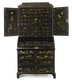 A Chinese Export parcel-gilt black lacquer desk-and-bookcase, mid-18th century. Sotheby's