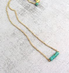 Gold necklace with blue turquoise stones, simple tiny