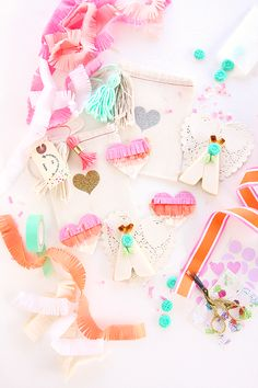 Teepee's, fringe hearts, glitter heart cloth bags, tassels and stamps, perfect Valentine's Day packaging.