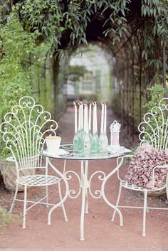 Candles in foam green soda bottles. Love the sexy curvy scrolly chairs!