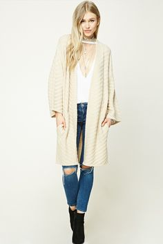 59d40a8779 A midweight knit cardigan featuring a textured chevron pattern