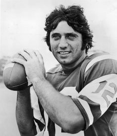 Joe Namath: Portrait of American football player Joe Namath wearing a football jersey printed with the number 12 and holding a football. (Photo by Hulton Archive/Getty Images) #football  #NYJets #Jets