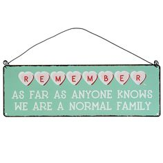 We're A Normal Family Metal Sign | DotComGiftShop