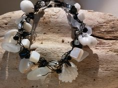 """Black crocheted wire with white shells and sea glass and mother of pearl nuggets, glass seed beads. Silver metal balls and black crystals. 71/2"""" CB01"""