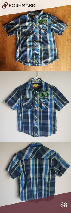 John Cena Button Down Shirt Plaid short sleeve button down. 2 front pockets with Cenation print on it. Has some fading due to wear. Size L (10/12) by the brand Never give up John Cena. John Cena Shirts & Tops Button Down Shirts
