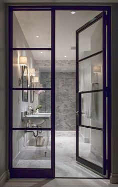 steel glass doors into master bathroom gray and white subway tile