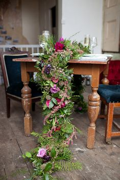 cascading floral table runner, photo by Ryan Welch Photography http://ruffledblog.com/welsh-floral-wedding-inspiration #weddingideas #tablerunners