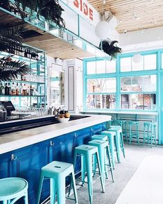 Can't get enough of the vibrant turquoise bar, paint trim and bar stools at Pizza Beach in NYC!