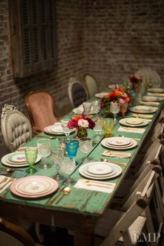 Rustic turquoise table, love the mismatched vintage chairs, plates and glassware, cozy & casual mood.
