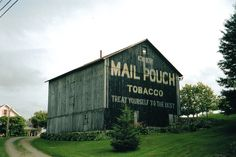 A Pennsylvania barn is seen with the well known Mail Pouch Tobacco sign on one of its end walls.