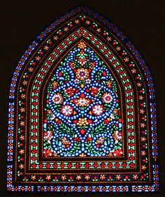 Unique art of glass design on a window in kashan , Iran
