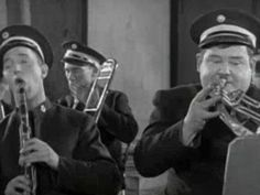 You're Darn Tootin', Stan Laurel and Oliver Hardy playing in the band, clarinet, french horn, laurel and hardy, stan laurel, oliver hardy