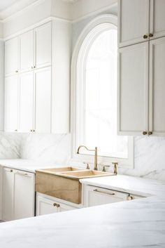 Want to take your all white kitchen to the next level? One way to do that is with a few carefully selected accents in gold (or in slightly more subtle brass, if