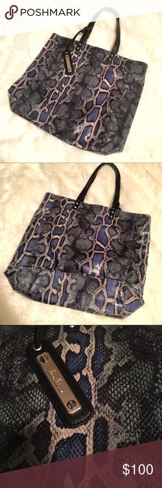 Sam Eldelman Tote - Faux Python Snake Snakeskin Beautiful tote by Sam Alderman. This is in great condition - no damage inside or outside. Inside looks unused! Features an inside zip pocket and two small open pockets (one fits my iPhone 6S). Magnetic closure. 15 in tall by 12 in across and 4 inches deep. Rise of handles is 9 inches. This is 100% PU so not real snakeskin! Beautifully made though with shades of green and blue. Let me know if you have any questions! Sam Edelman Bags Totes