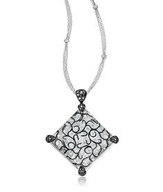 Cellini Jewelers Black and White Diamond Arabesques Pendant is overlayed with a 50.35 carat rock crystal magnifying the design and adding depth to the piece.