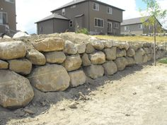 Imagine this rock retaining wall being 15' taller and you'd get what I want to wrap around my house <3