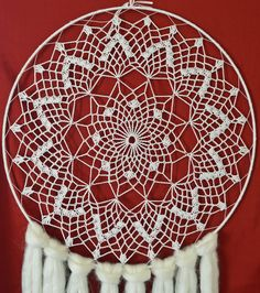 This is a vintage crochet 18 round Dream Catcher. White/Light color would look great on any wall in any room. This piece is a beautiful display of vintage style mixed with native style.  Made out of cotton thread with soft roving, wooden beads and gold tipped white feathers. Light weight and elegant.  Gift Ideas: Wedding, Birthday, Anniversary, House Warming, Holidays  Care instructions: Spot clean only with cold water.  Made by me and shipped throughout the USA. This piece will ship wit...