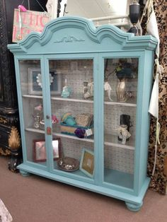 $245 - This painted curio Hutch has a blue exterior and a soft grey interior with glass shelves and a light. The cabinet measures 52 inches across the front, approximately 15 inches deep and it stands just over 60 inches to the tallest point. It can be seen in booth D 8 at Main Street Antique Mall 7260 East Main St ( E of Power Rd ) Mesa 85207 480 9241122open 7 days 10 till 530  Cash or charge 30 day layaway also available