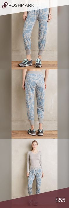 """Anthropologie floral print jogger XS NWT Anthropologie floral print jogger. Size XS. NWT. Cotton-polyester knit Tapered fit Adjustable cord at waist 24"""" inseam                                                               Grey with blue print Anthropologie Pants Track Pants & Joggers"""