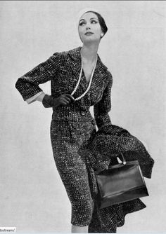 1957 Simone in wool suit and matching overcoat by Nina Ricci, photo by Guy Arsac