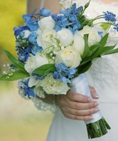 white roses, blue delphinium, muscari and a small bit of lily of the valley