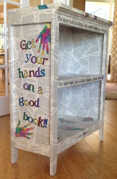 silent auction, class craft *This is the bookcase I made last year for my daughter's 2nd grade class project. Items used: inexpensive bookcase, cheap Classic children's novels from Dollar store, liquid watercolor for handprints, acrylic paint and permanent markers for lettering, clear polyurethane in Satin finish.