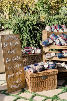 "Blankets make thoughtful wedding favors for winter affairs. ""To have and to hold in case you get cold,"" the sign reads. Courtesy of A Good Affair"