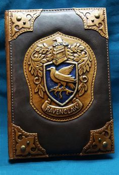 Leather notebook cover Ravenclaw, harry potter ravenclaw cover leather, leather harry potter book co Harry Potter Notebook, Harry Potter Planner, Harry Potter Book Covers, Rowling Harry Potter, Leather Book Covers, Leather Books, Leather Notebook, Leather Cover, Ravenclaw