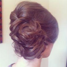 Low side bun with loose curls pinned up. Wedding hair. Bridal hair styles. Bride hair or bridesmaids hair. Updo.