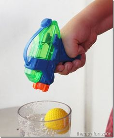 water pistol to fill cup & tip ball out - great finger strengthening