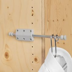 The Pull Out Mini Rod from Ambos can be attached to a wall or under a shelf.  Usually tucked away, it can be extended out (as shown here) to provide a handy spot to hang items while you change, or even while you give them a quick steam. Ideal for wardrobes, bedrooms, bathrooms, pool changing room, or anywhere you might be donning or removing clothing.