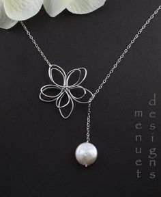 Our distinctive original flower and pearl lariat-style necklace featuring a double layered wire flower and a lustrous high quality freshwater coin
