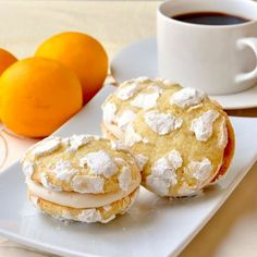 Lemon Cream Cheese Crackle Cookies - tender lemon cookies with a cracked exterior sandwiched together with a velvety cream cheese frosting. Delicious!
