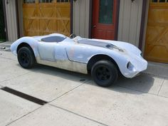 Interesting sports car: unknown fiberglass body; MG chassis, Alfa engine. On eBay now.