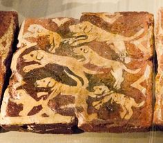 The pack of hounds - encaustic tile c1300 from Neath Abbey.  Originally from National Museum of Cardiff