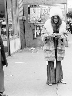 Janis Joplin poses for a portrait on March 3, 1969 outside of the entrance to the Chelsea Hotel in NYC, New York. Photo by David Gahr.