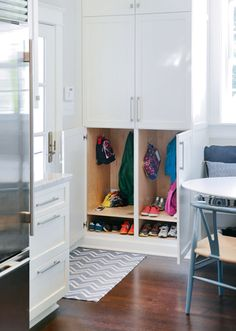 YHL's new kitchen (3rd house), includes individual cubby/drop zone within cabinets that blend into kitchen.  Need this, since we also enter/exit through the side door, far from the hallway coat closet!
