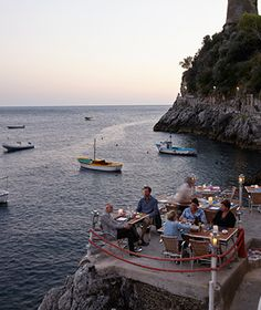 Europe's Best Places to Eat Like a Local: Il PirataAntonio Sersale, owner of Positano's Le Sirenuse hotel, swears by the sea-urchin linguine at this Amalfi Coast idyll, where a sun-drenched terrace is built into rocks above a glittering cove. Via Terramare. $$$