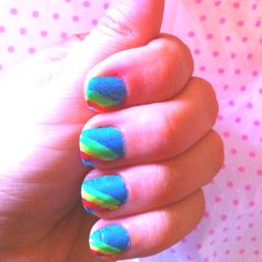 Rainbow. Blue base with blue glitter on top and then stripes in green yellow and pink on top.