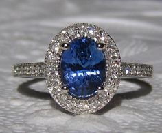 Blue Sapphire Engagement Ring, AGL Certified Untreated Ceylon Cornflower Blue Sapphire in White Gold Milgrain Diamond Halo Engagement Ring by JuliaBJewelry on Etsy https://www.etsy.com/listing/197878135/blue-sapphire-engagement-ring-agl
